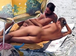 Russian duo sunbathing nude and making..