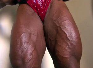 Dark-hued dame bodybuilder in crimson..