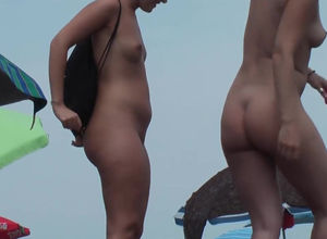 Curvaceous Mummies bare on the beach..