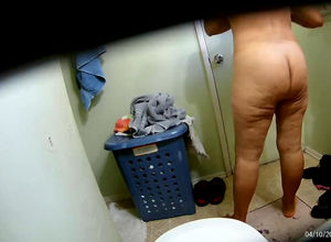Chubby mature undressing in toilet in..