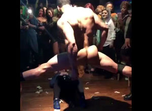 Muscled male stripper dancing in the..