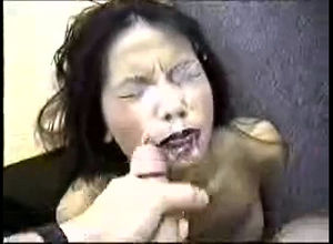 Japanese woman inhales and gets a..